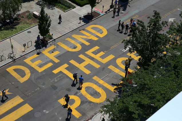 Defund the Police, painted in yellow on the street in Washington, DC